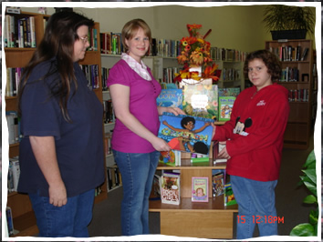 Members of the local Church of Christ donate several Children's books to the library.