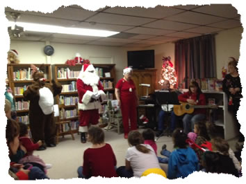 Rudolph reads to the children